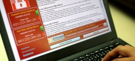 Cyber attack sweeps globe, researchers see 'WannaCry' link